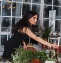 Beautiful girl decorate table for Christmas and evergreen centerpiece
