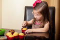 Beautiful girl decorating cupcakes portrait of a little with chocolate at home Royalty Free Stock Photo