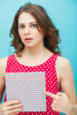Beautiful girl with a diary in red polka dot blouse on blue background Stock Images