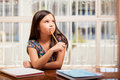 Beautiful girl doing homework Royalty Free Stock Photo