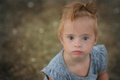 Beautiful girl with Down syndrome on the beach Royalty Free Stock Photo