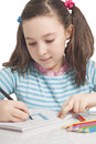Beautiful girl is drawing with color pencils Stock Photography