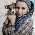 Beautiful girl with dreadlocks and dog puppy jack russell terrie terrier Stock Photos