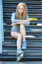 Beautiful girl with dreadlocks portrait of a rollerskates on her legs Royalty Free Stock Photography