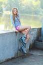 Beautiful girl with dreadlocks portrait of a rollerskates on her legs Stock Photos