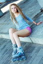 Beautiful girl with dreadlocks portrait of a rollerskates on her legs Royalty Free Stock Image