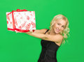 Beautiful girl in a dress with gifts on green background Royalty Free Stock Photos