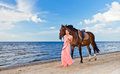 Beautiful girl dress horse seacoast Royalty Free Stock Photo