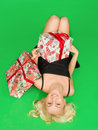 Beautiful girl in a dress lay on the floor with gifts gift green background Stock Photo