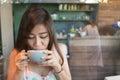 Beautiful girl drinking hot coffee or tea in coffee cafe model asia women female of thai people Stock Photos