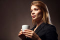 Beautiful girl drinking tea or coffee cup of hot beverage Royalty Free Stock Image