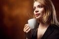 Beautiful Girl Drinking Tea or Coffee Royalty Free Stock Photo