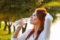 Beautiful girl is drinking water from a bottle Royalty Free Stock Photo