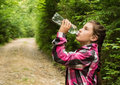 The beautiful girl drinks water Royalty Free Stock Photo