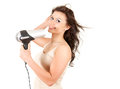 Beautiful girl drying her hair by dryer Royalty Free Stock Photography