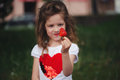 Beautiful girl eating big juicy strawberry Royalty Free Stock Photo
