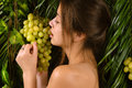 Beautiful girl eating grapes Royalty Free Stock Photo