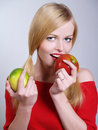 Beautiful girl with the eating red apple Stock Images