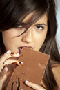 Beautiful girl eats chocolate Royalty Free Stock Photo
