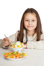 Beautiful girl eats dessert isolated on white background Royalty Free Stock Image