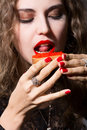 Beautiful girl eats a sandwich with red caviar vitamins are good for calories Royalty Free Stock Photography