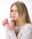 Beautiful girl enjoying coffee on a white background Stock Photography