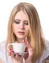 Beautiful girl enjoying coffee on a white background Royalty Free Stock Images
