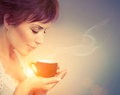 Beautiful girl enjoying coffee woman with cup of hot beverage Royalty Free Stock Images