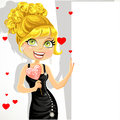 Beautiful girl in evening dress with heart candy Royalty Free Stock Photos