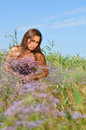 The beautiful girl is in the field covered with flowers Royalty Free Stock Photography