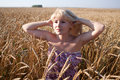 The beautiful girl in the field with wheat Royalty Free Stock Photography