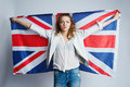 Beautiful girl with flag of britain the Stock Photo