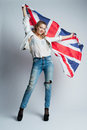 Beautiful girl with flag of britain the Stock Images