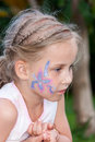 Beautiful girl with flower paining on her face Royalty Free Stock Image