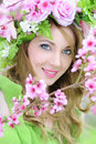 Beautiful girl in a flowered garden peach Royalty Free Stock Photo