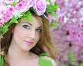 Beautiful girl in the flowered garden peach Royalty Free Stock Photo