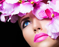 Beautiful girl with flowers and perfect makeup on black background Royalty Free Stock Photo