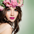 Beautiful Girl with Flowers Wreath. Long Permed Curly Hair Royalty Free Stock Photo