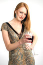Beautiful girl frowns on alcohol in studio Royalty Free Stock Image