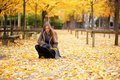 Beautiful girl gathering leaves in park autumn Royalty Free Stock Photography