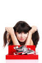 Beautiful girl with gift in red box with silver ribbon on white background Stock Photo