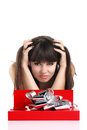 Beautiful girl with gift in red box with silver ribbon on white table Royalty Free Stock Photo