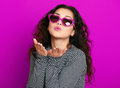 Beautiful girl glamour portrait on magenta make flying kiss Royalty Free Stock Photo