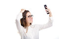 Beautiful girl in glasses and a white shirt takes a picture of herself on the camera phone, selfie on white isolated background Royalty Free Stock Photo