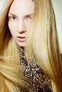 Beautiful girl with golden hair tended Royalty Free Stock Images