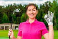 Beautiful girl with a golf equipment smiling Royalty Free Stock Photos