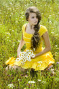 Beautiful girl in green field Royalty Free Stock Photo