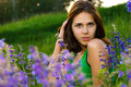 Beautiful girl on green field Royalty Free Stock Photography