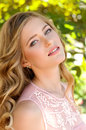 Beautiful girl in green garden Stock Photo