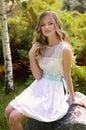 Beautiful girl in green garden Stock Photos